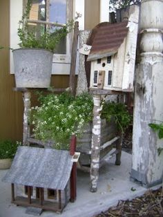 Weathered porch post and chair. Galvanized wash tub and bucket planters.  Birdhouses. (sweet pea home)