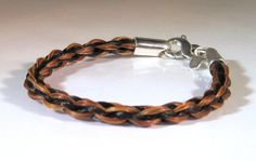 Caracol - Inspired Jewelry and Handbags - Horsehair Semi-Round Braid Bracelet 5mm, $165.00 (http://www.caracolsilver.com/horsehair-semi-round-braid-bracelet-5mm/)