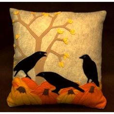 .Crows on pumpkins, does it get any better?  We should all have pillows this cool.