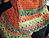 Openwork crocheted scarf in rich autumn colors.  This scarf can brighten and beautify a jacket or coat to give you a stunning look.