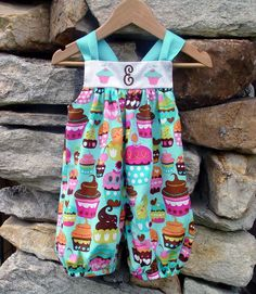 This romper is made with our popular cupcake fabric, features bubble legs that hit above knee, white pique yoke and aqua ribbon ties. $26. On sale now at www.facebook.com/jdoriginals.