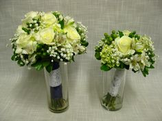 Hand tied wedding bouquets of Escimo roses, mini green hydrangea, white alstromeria, green hypericum berries and babies breath. Bound simply with white lace.