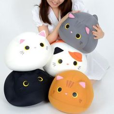 Squishy kitties! These beanbag cat plushies come in five equally cuddle-able varieties, each with Mogucchi's signature big eyes, tail, and ears. They double as