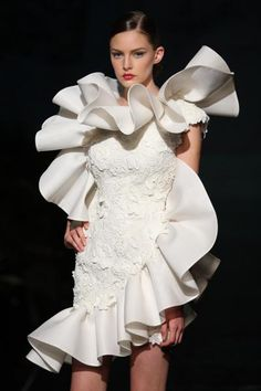 Very unusual bridal dress - Who would hold up the sign for the congregation not to burst out laughing?