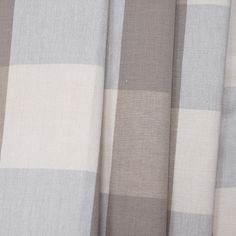 A classic, neutral buffalo check in putty-stone, cream and a pale dusty blue.Perfect for drapery, roman blinds, curtains, pillows, seat cushions, slipcovers and