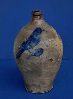 Ovoid stoneware jug with bird