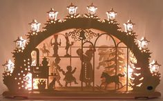 A Schwibbogen is a decorative candle-holder from Germany. Associated exclusively with winter and the holiday season, the first Schwibbogen . German Christmas Decorations, German Christmas Markets, Christmas Scenes, Holiday Decorations, Nutcracker Christmas, Christmas Candle, Christmas Crafts, Xmas, Christmas Items