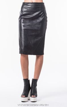 Midi pencil skirt from eco-leather fabric with side insertions from coated fabric with gravel-like texture, lining and back zipper. The Skirt is a casual garment, but can also be successfully accessorized with a crisp shirt and make it into an office look. It is that kind of product that can be worn in a day to evening outfit.