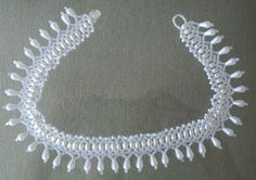 Pattern from beadsmagic.com Wedding necklace. I only did 3 rows.