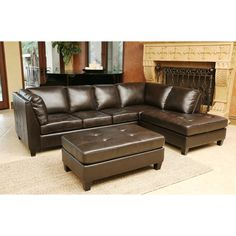 Enhance the comfort of your seating options with the inviting warmth of this sectional sofa and ottoman set. The hand-stitched details on the tufted cushions adds intriguing depth to the dark brown upholstery.