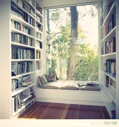 This library nook might be even better than the first pin! I love the amazing picture window.
