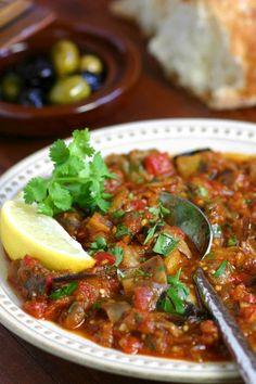 This warm Moroccan Eggplant Salad (Zaalouk) combines cooked eggplant, tomatoes, and classic spices and is enjoyed as a side or alone with lots of bread. Vegetable Recipes, Vegetarian Recipes, Cooking Recipes, Healthy Recipes, Vegetarian Times, Roasted Eggplant Salad, Morrocan Food, Moroccan Salad, Lebanese Recipes