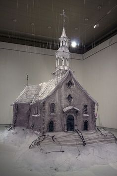 Large grey fiber church with black thread accents and translucent white thread in front