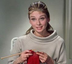 Audrey Hepburn as Holly Golightly, knitting in 'Breakfast at Tiffany's'.