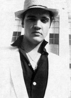 Elvis Presley photographed outside of the MGM studios in Hollywood, California - (around May) 1957 | Also see: https://de.pinterest.com/pin/380906080965928678/ and https://de.pinterest.com/pin/380906080965928653/ Elvis is wearing the large medallion he got from 14-year-old super-fan Carol Vanderleck backstage at Maple Leaf Gardens in Toronto, Canada on April 2, 1957 before the first show and that he wore on stage the same evening.