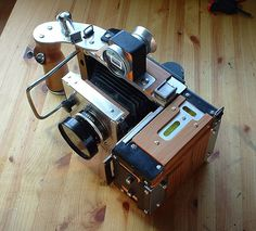 medium to 4x5'' camera I made in 2005. Interchangeable backs and lenses. Shoots from medium to 4x5 ( could be 5x7, but it's not worth the hassle ). Lens movements - up/down only. www.twelvecameras.com