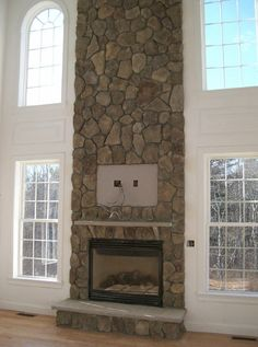 fireplace to ceiling | Stone floor-to-ceiling fireplace (2-story)