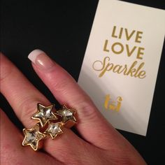 NWT Gold & Crystal Starburst Ring NWT.  Beautiful gold plated base metals and glass star crystals.  Three available in size 6.  Also available in size 7 under a separate listing. T&J Designs Jewelry Rings