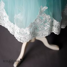 A lovely mint and lace dress with a silver stuffed bow - perfect for any special occasion! Offered by Itty Bitty Toes!