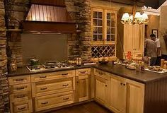 Wouldn't mind doing the actual ledge rock as the backsplash too... This is gorgeous! But may make the kitchen feel too small?