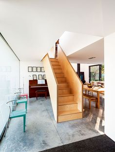 A stunning, utterly unique contemporary remodel and extension to a standard post-war detached home Timber Staircase, Wooden Staircases, Staircase Design, Stairs, Staircase Contemporary, Bungalow Renovation, Luxury Interior Design, Concrete Floors, Building A House