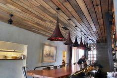 The Little Water Cantina in Seattle WA took advantage of the warmth and character of Circle Sawn for their bar ceiling. Photo by Gregg Snodgrass. Bar Ceilings, Barn Siding, Pendent Lighting, Mountain Living, This Ole House, Lights, Modern Spaces, Plafond Design, Reclaimed Wood Bars