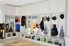Bike helmet & gear storage locker room style! Cool idea for a garage makeover!