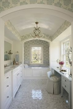 clean, white bathroom with a beautiful bathtub, glamorous chandelier, and long vanity -- 6 Beautiful & Luxurious Bathrooms from Pinterest from Bathroom Bliss by Rotator Rod