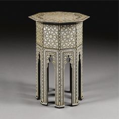 An Ottoman mother-of-pearl and ebony-inlaid octagonal coffee table, Turkey, 19th Century
