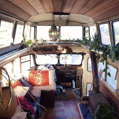 If you're going to live in a bus, might as well have lots of windows. And plants. And pillows. ;)