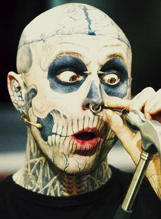 Rick Genest / zombie boy / tattoos  silly face hammering nose stud back in