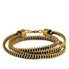 Wrap Zipper Bracelet Golden  by Andrea Valentini    < Return to Andrea Valentini  33  0        $29fab        $45 retail price      Quantity      Add to Cart    The shiny gold-colored Wrap Zipper Bracelet has serious industrial appeal—perfect for bringing a bit of edge to girlie get-ups or making an accessorial statement when you're outfitted in business casual.