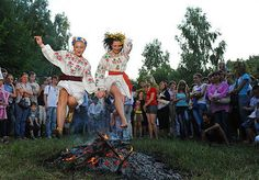 TOPSHOTS Ukrainians wearing traditional clothing jump over a campfire while celebrating Ivan Kupala Night, a traditional Slavic holiday not far from Kiev on July 6, 2009. During the celebration, originating in pagan times, people plait wreaths, jump over fires, and swim naked.