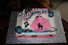 Buttercream icing with fondant figures, 50`s themed party.