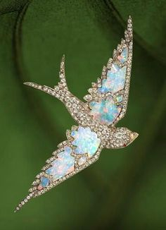 AN ANTIQUE OPAL AND DIAMOND SWALLOW BROOCH, circa 1870