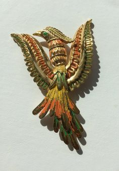 This rare piece from Vendome is a large Phoenix brooch in gold tone metal with green and orange enamel feathers. It represents the mythological Phoenix bird.  Dramatic figural brooch in very good vintage condition and signed.  3.5 in long 2.25 in. high .25 in. high