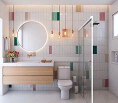 Banheiro | Neste banheiro criamos uma paginação inusitada com os azulejos de metrô, tendência incontestável, de uma forma descolada pinceladas de cor dão vida ao ambiente.   Inspirado na estética minimalista, o projeto traz uma atmosfera leve e elegante.   Que tal?! 💗🧡💚💙 ⠀⠀⠀⠀⠀⠀⠀⠀⠀⠀ ⠀⠀⠀⠀⠀⠀⠀⠀⠀⠀ ⠀⠀⠀⠀⠀⠀  Revestimentos utilizados:   Bella Vitta wh/sgr/be/dgn/cr 8x25cm da @ceramicaportinari