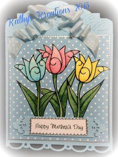 The peel off tulips are from Elizabeth Craft Design. Glittered and painted with Coopic markers.  The card is designed and cut on my Silhouette.