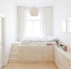 Making the most of a small room -- platform bed with storage -- digging.