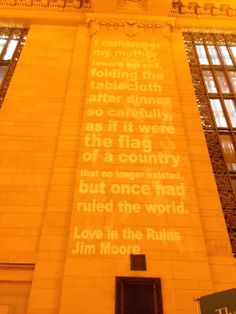 "Another shot of Jim Moore's poem, ""Love in the Ruins"" projected in Grand Central Station! Photo courtesy of the Poetry Society of America."