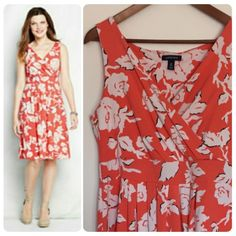 Lands' End sundress sz M. Floral print! So soft! Lands' End sundress. Size: Medium (10-12). Chest: 18.5 inches. Waist: 16 inches. Length: 38 inches. (All measurements taken with dress laying flat.) Orange and white Floral print. V neck. Knee length. No zippers, ties or closure. Pull over style. Like new condition. So soft and effortlessly cute! Lands' End Dresses
