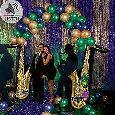 The Saxophone Balloon Arch features two cardboard saxophones accented with Mardi Gras masks, beads and Bourbon Street signs. This Sax Arch measures 9 ft high x 8 ft wide.