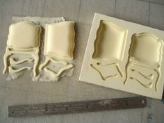 MULTIPLE tutorials for model making, buildings, furniture, people, etc...this photo is showing a mould made for casting a chair.  direct link  http://davidneat.wordpress.com/2013/06/26/beginners-basics-mouldmaking-and-casting/