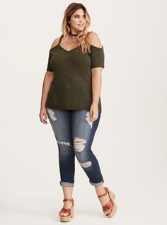 "Just because the weather's warming up doesn't mean you have to hit pause on all your sweater-y styles. This olive green knit has a textured look and feel, with short cold shoulder sleeves that are like anti-cold-weather. The strappy back maintains the stop-winter movement.<div><br></div><div><b>Model is 5'10"", size 1<br></b><div><ul><li style=""list-style-position: inside !important; list-s..."