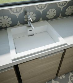 lavanderia invisibile di design - lavatoio con tavoletta rimovibile ergonomica