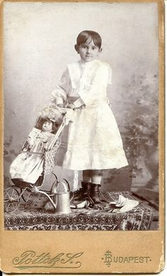 Child with her doll and stroller.