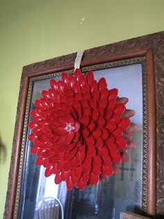Wreath made from plastic spoons. Chairs from the Curb: Spoon River.