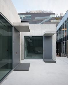 nobuo araki combines three concrete blocks in the mass museum in tokyo