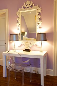 Love the mirror & the ghost chair.