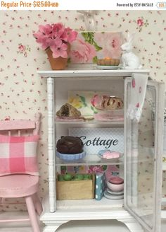 A personal favorite from my Etsy shop https://www.etsy.com/listing/228174458/on-sale-spring-bakery-glass-hutch-filled